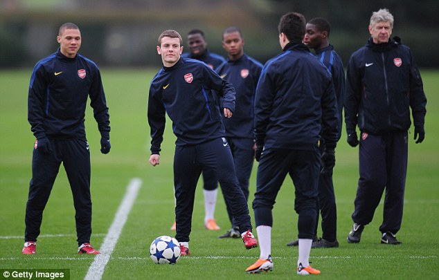 Gunning for glory: Arsene Wenger cats an eye on his Arsenal players, including Jack Wilshere, in the build-up to Wednesday's crunch Champions league tie against Barcelona