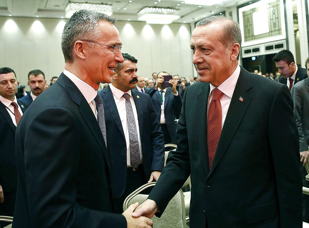 Turkey's President Recep Tayyip Erdogan (right) and NATO Secretary General Jens Stoltenberg shake hands as they attend a NATO parliamentary assembly meeting in Istanbul on Monday, Nov. 21. Erdogan has called on the United States and other nations to re-assess his country's proposal for the creation of a no-fly zone in northern Syria. (Kayhan Ozer, Presidential Press Service, Pool photo via AP)