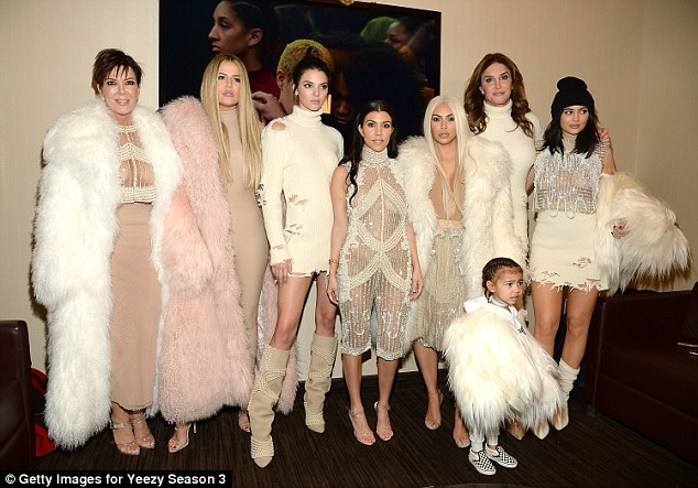 The old Kim: With her family (from left) Kris, Khloe, Kendall, Kourtney, Caitlyn, Kylie and North in February for the Yeezy show