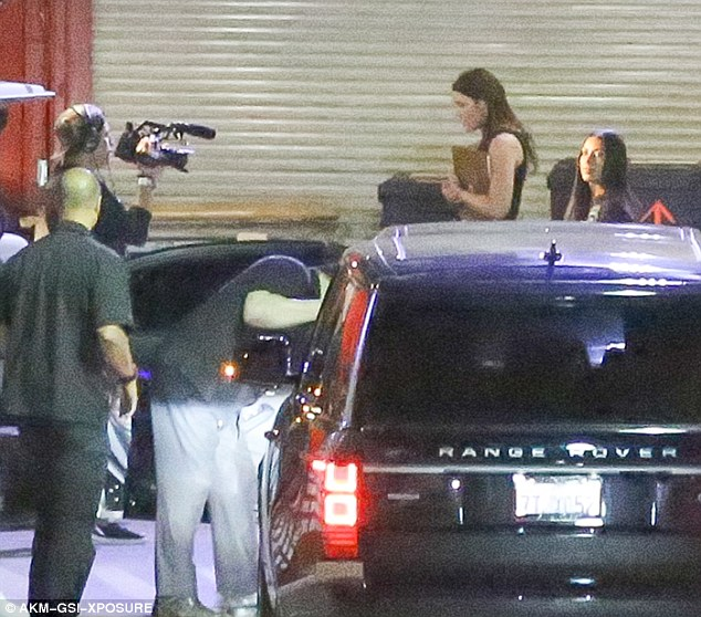 Camera crew:Kim Kardashian had the Keeping Up With The Kardashians cameras on her as she entered Kanye West's concert at the Forum in LA on Tuesday night