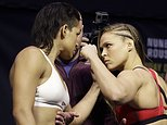 Ronda Rousey, right, and Amanda Nunes face off for photographers during an event for UFC 207, Thursday, Dec. 29, 2016, in Las Vegas. Rousey is scheduled to fight Nunes in a mixed martial arts women's bantamweight championship bout Saturday in Las Vegas. (AP Photo/John Locher)