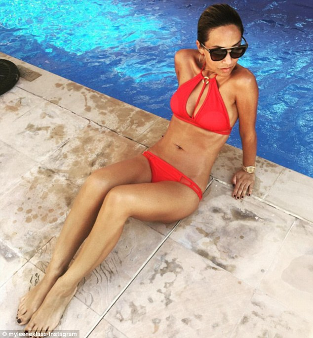 Red hot: The TV and radio presenter, 38, looked phenomenal in a barely-there crimson bikini which showed off her washboard abs and cleavage on Wednesday