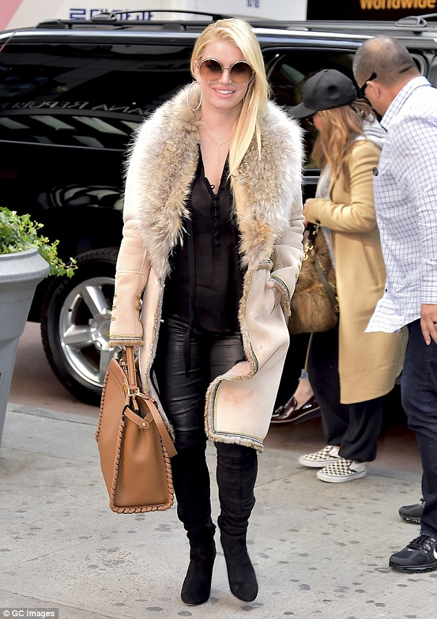 Eye-catching: Jessica Simpson bundled up in a fur-lined coat as she stepped out in New York City on Wednesday