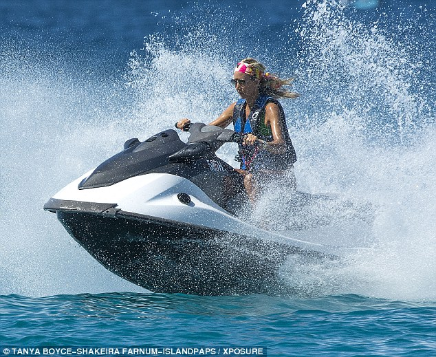 Speed demon: The blonde's tanned skin glistened in the Caribbean sun