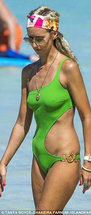 Beach babe: The swimsuit's unusual cut showed off her slender side