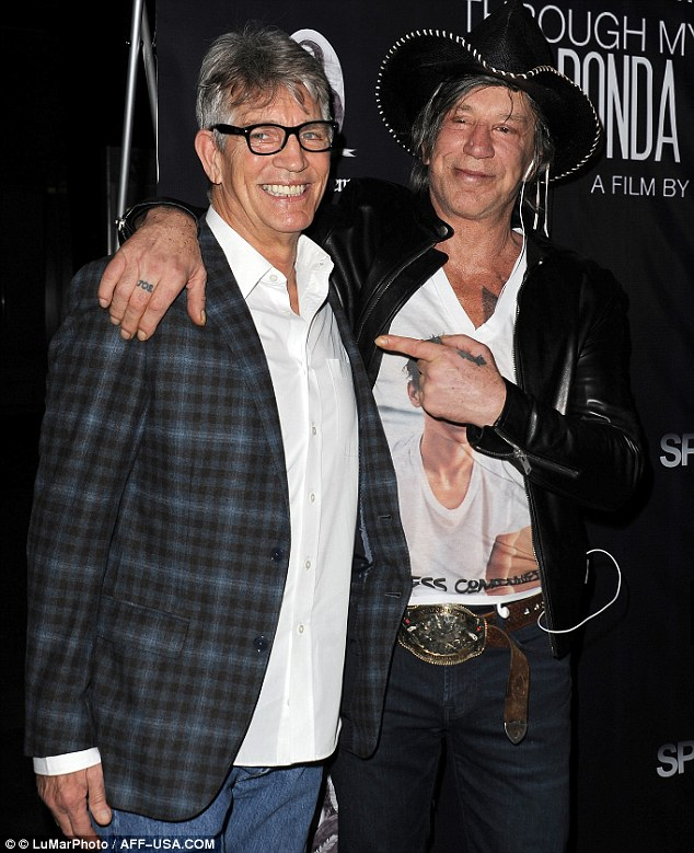 Famous duo: Rourke posed for photos at the event with fellow guest, actor Eric Roberts, 60