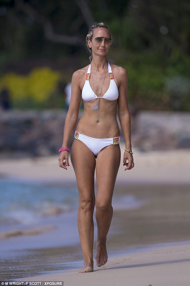 Bit of al-white! Lady Victoria Hervey kept her famous assets firmly in place as she turned heads in a white bikini in Barbados on Thursday