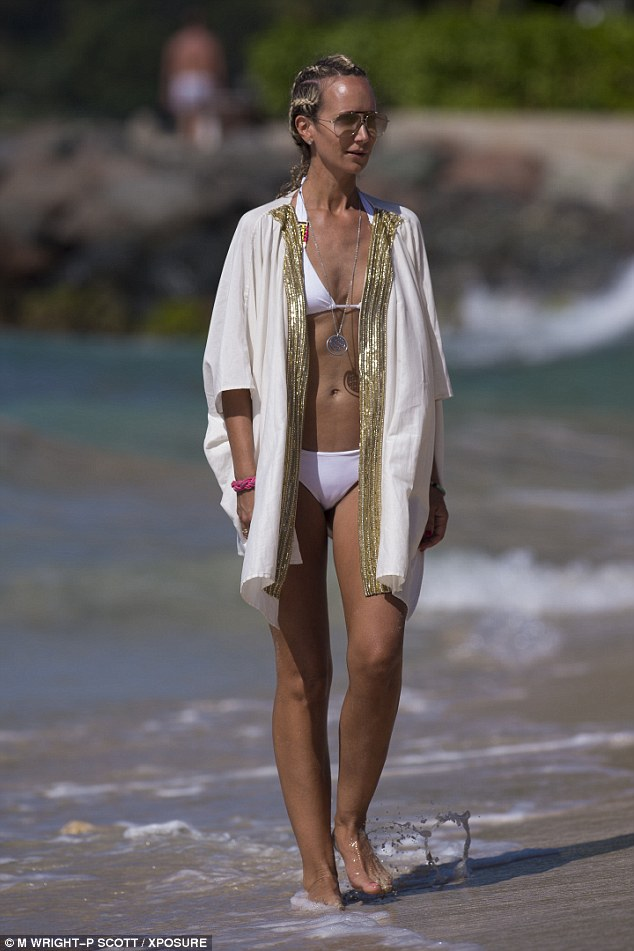 Abs-fab! Flaunting her fabulous form, Victoria took a walk along the picturesque beach