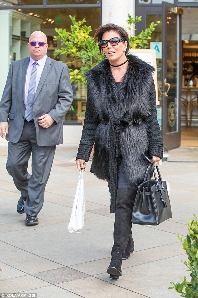 No way: Kris Jenner would never have allowed so much surgery, says Kylie. Here the momager, 60, is seen on Monday with a security guard