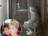 'She was mesmerized by her mother': Photographer who captured the iconic picture of Carrie Fisher watching mom Debbie Reynolds on stage reveals the pair's adoring relationship