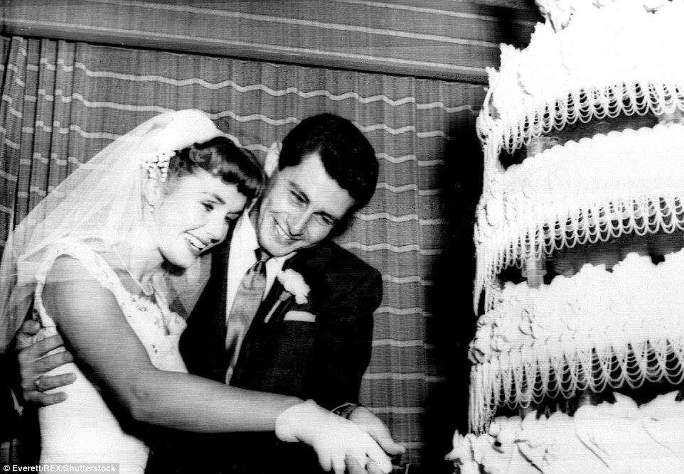 In 1955, Reynolds married her first husband Eddie Fisher (pictured cutting their wedding cake together). The wedding was Hollywood's hottest ticket with both Reynolds and her groom carrying serious celebrity pedigree