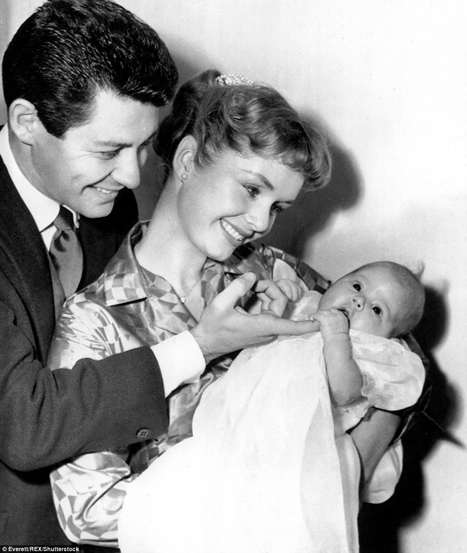 The actress had two children, Carrie and Todd Fisher, with her first husband, singer Eddie Fisher (pictured holding a three-month-old Carrie in January 1957)