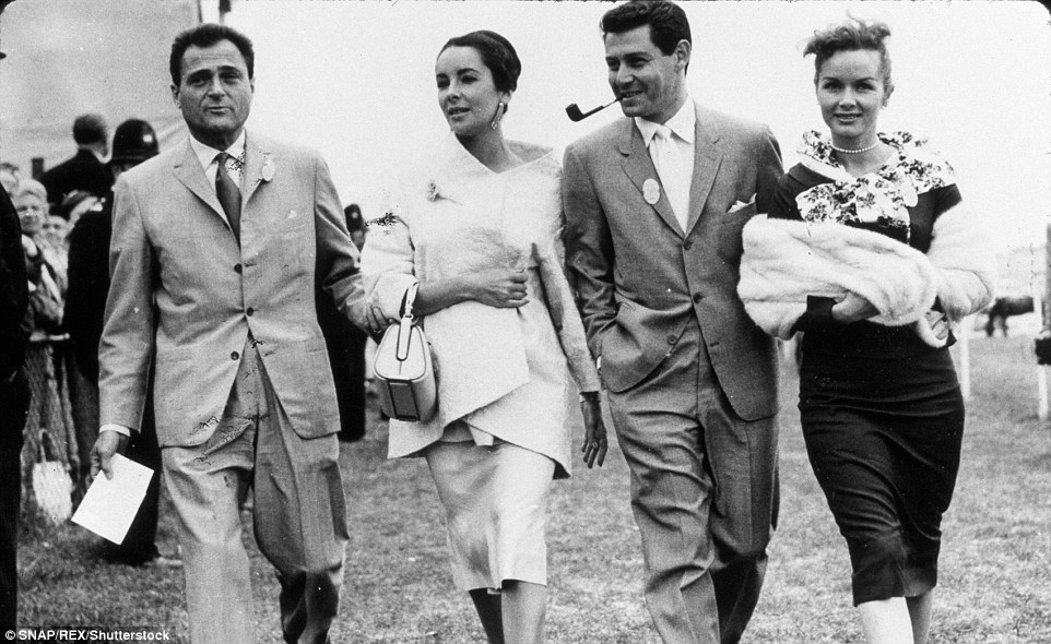 Reynolds, pictured with her first husband Eddie Fisher in 1957, was good friends with fellow film star Liz Taylor, also pictured with her husband Mike Todd