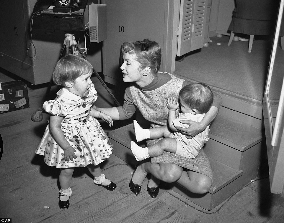 Reynolds had another child, Todd, with Eddie Fisher in 1958 before the couple divorced in 1959 (The actress is pictured with her children Carrie, 2, and Todd, 1, in 1959, while working long hours on the set of Say One For Me)