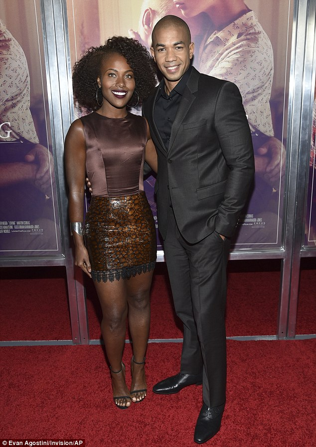 Couple: Underground's Alano Miller (R) - who plays Raymond Green - suited up in all-black alongside his actress wife of seven years, DeWanda Wise (L)
