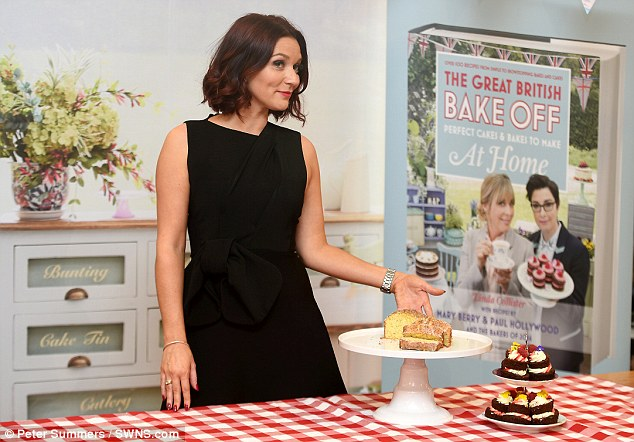 The amateur baker (pictured) was also wearing her trademark heels and lipstick for her first day of the job