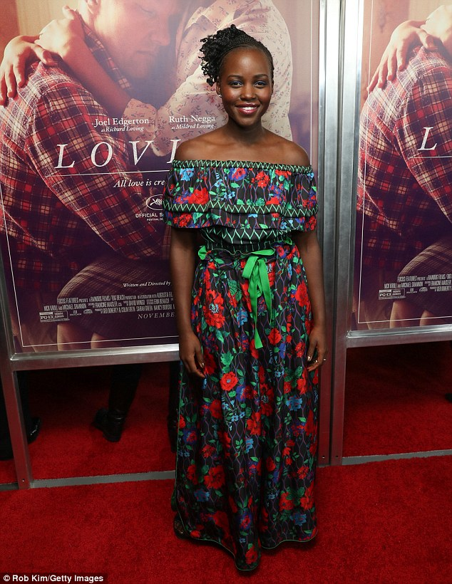 Rosy: Lupita Nyong'o wore yet another vibrantly-patterned creation while attending the Manhattan premiere of Loving on Wednesday