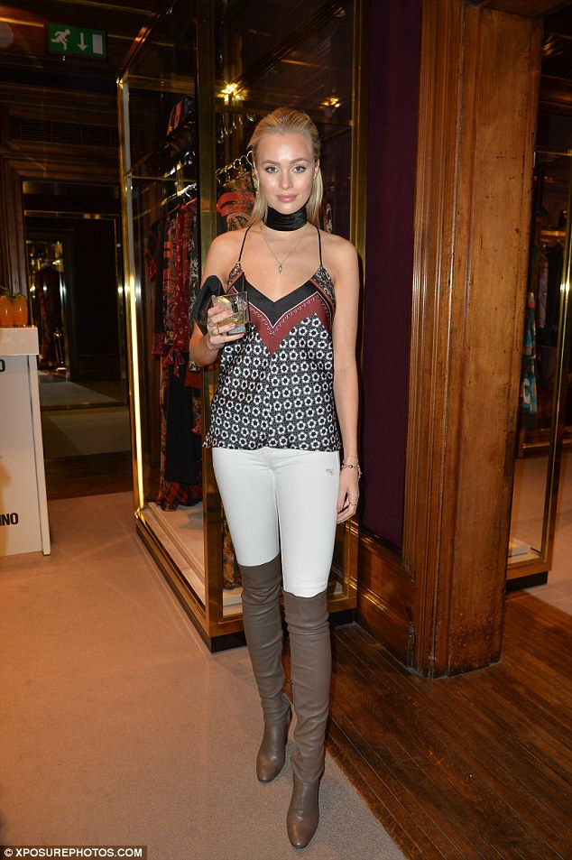 Model material: Lingerie model Ianthe Rose wore a lightweight patterned vest top with a skintight pair of white trousers and over-the-knee boots