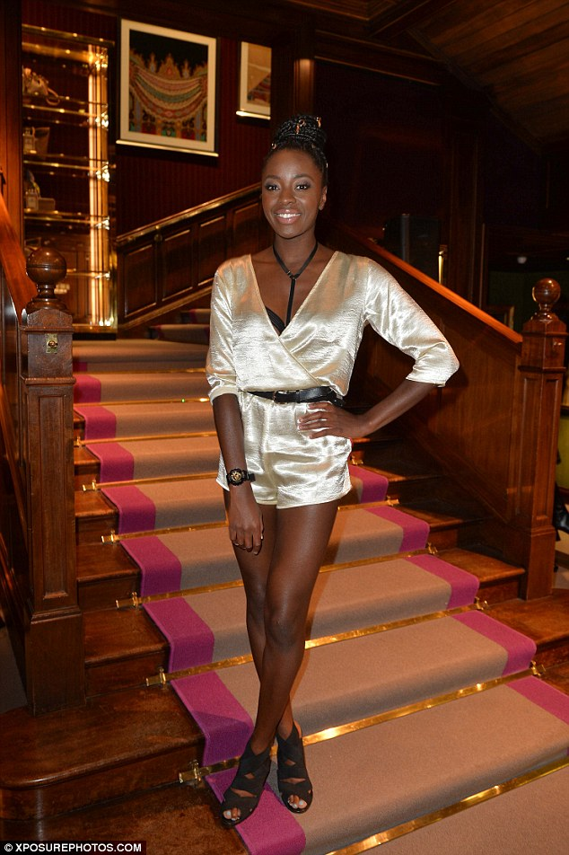 Dazzling: Her satin pearl playsuit certainly caught the eye