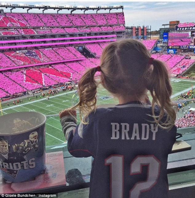 Cute: Gisele also recently shared a sweet snap of her little girl Vivian Lake supporting New England Patriots star quarterback Tom Brady