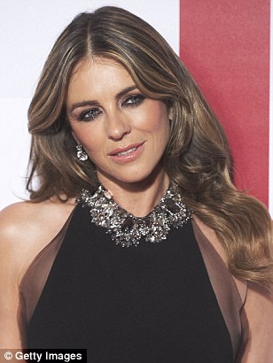 Dripping in diamonds:A bold statement necklace gave the look a striking focal point, while its tastefully fitted upper-half drew attention to Elizabeth's undeniably toned physique