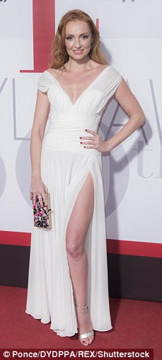 Leggy ladies!Cristina Castano opted for a thigh high split