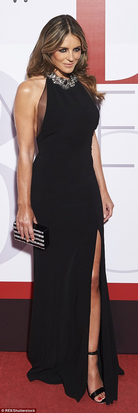 Beautiful in black:Opting for a classically styled sleeveless black gown with daring thigh thigh split, the seemingly ageless Elizabeth looked stunning as she posed for photos before making her way inside