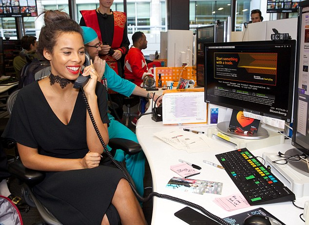Little black dress:Rochelle Humes and Suki Waterhouse traded in their day jobs to throw their support the annual Bloomberg Tradebook Charity Day in London on Thursday