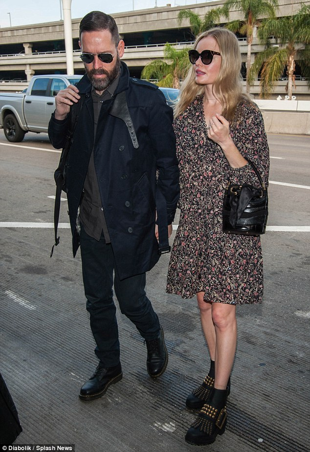On the go: Kate Bosworth was spotted at LAX on Wednesday preparing to jet off somewhere with her husband Michael Polish