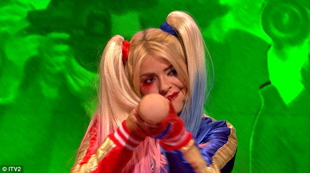 Taking aim:Brandishing a toy baseball bat and sporting the heavily applied make-up and girlish dyed pigtails synonymous with the edgy super-villain, a seemingly worse for wear Holly is radically transformed