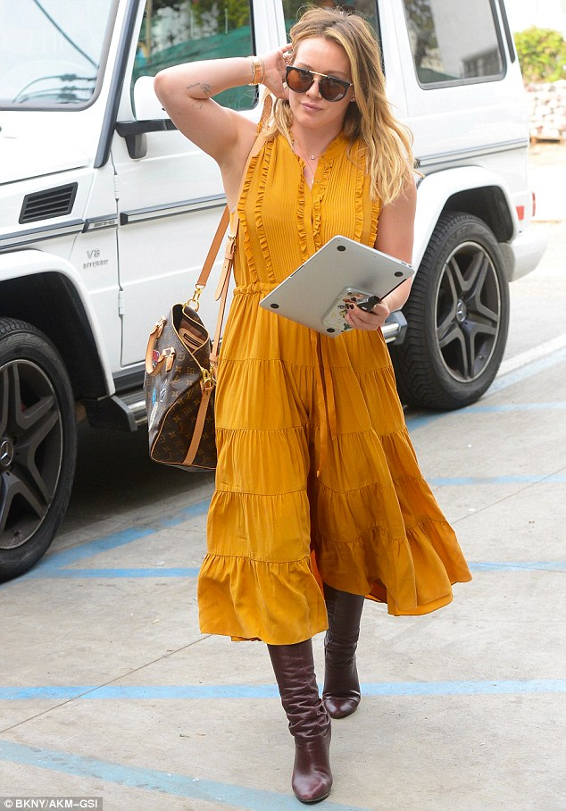 Mustard maven: The mother-of-one later changed up her look as she headed to a hair appointment at the Nine Zero One Salon