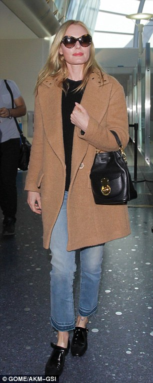 Jet-setter: Kate was pictured landing in Los Angeles on Friday after her trip to New York
