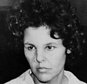 """FILE - In this Oct. 21, 1981 file photo, Judith Clark is taken into police custody in Nanuet, N.Y. Clark, a former radical who drove a getaway car during the 1981 Brinks armored car robbery will be eligible for parole in 2017 following a commutation from New York Gov. Andrew Cuomo on Friday, Dec. 30, 2016. On Monday Jan. 2, 2017, Cuomo said Clark impressed him as """"community-oriented"""" when they met and that he believes the former radical should be able to make her case for freedom. But the Democratic governor emphasized that the decision will rest with a parole board. (AP Photo/David Handschuh, File)"""