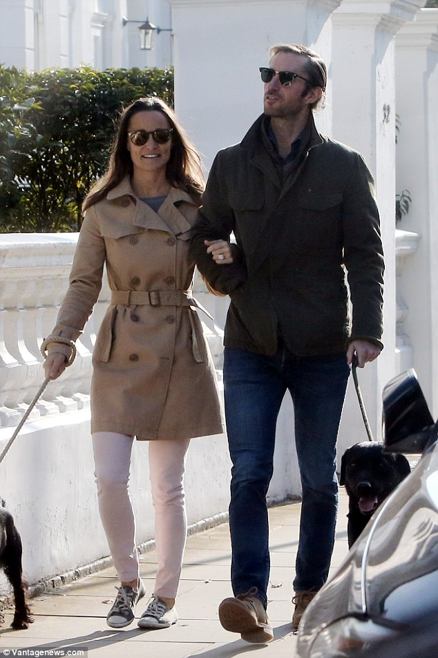 Pippa and James walked arm in arm with their dogs, the first time they have been pictured together since their engagement