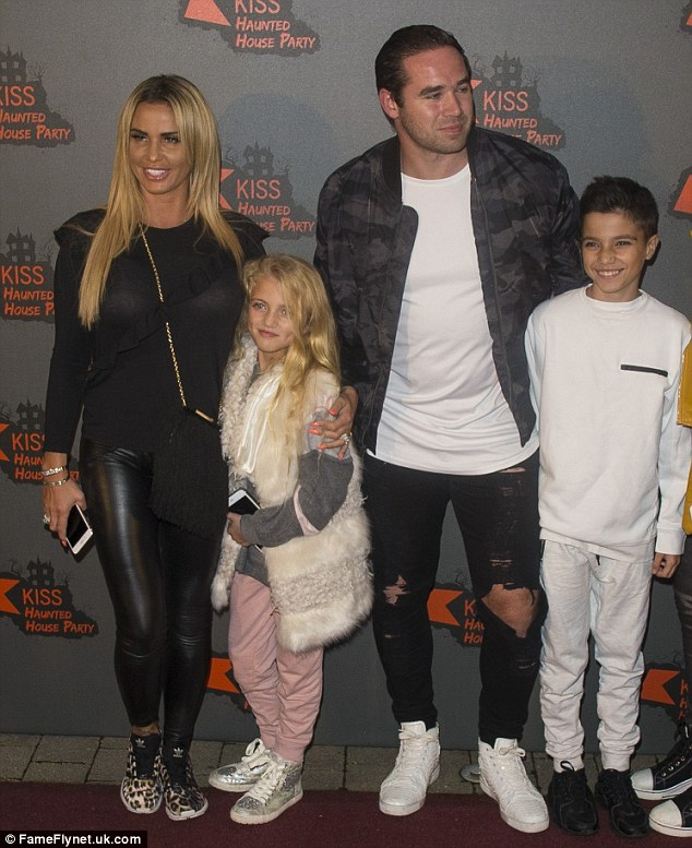 Close: Katie ensured her family enjoyed themselves at the star-studded event on Thursday