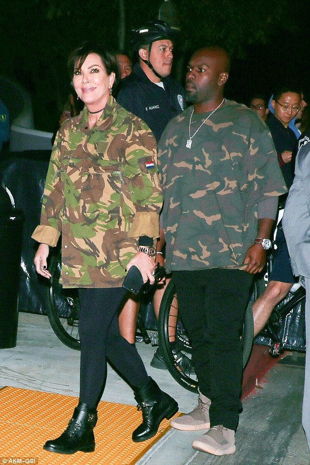 Blending in! Kris Jenner and boyfriend Corey Gamble matched in camouflage as they arrived for the second night of West's show at The Forum in Inglewood