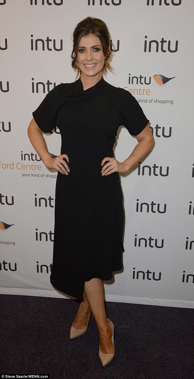 Sophisticated: Kym Marsh shows off her toned figure in a little black dress