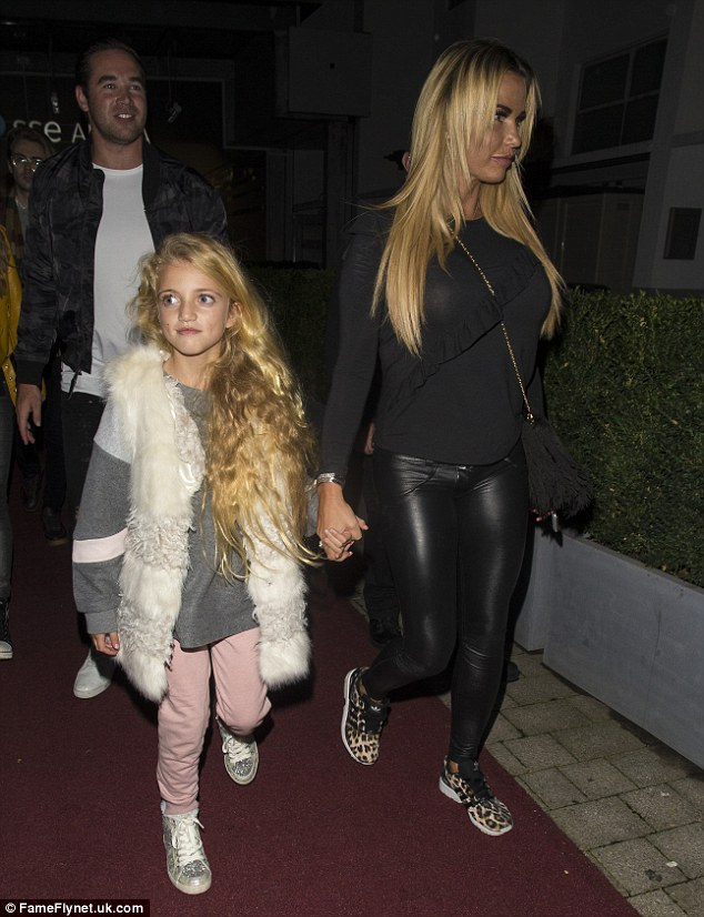 Like mother, like daughter: Katie walked hand-in-hand with her eldest daughter Princess