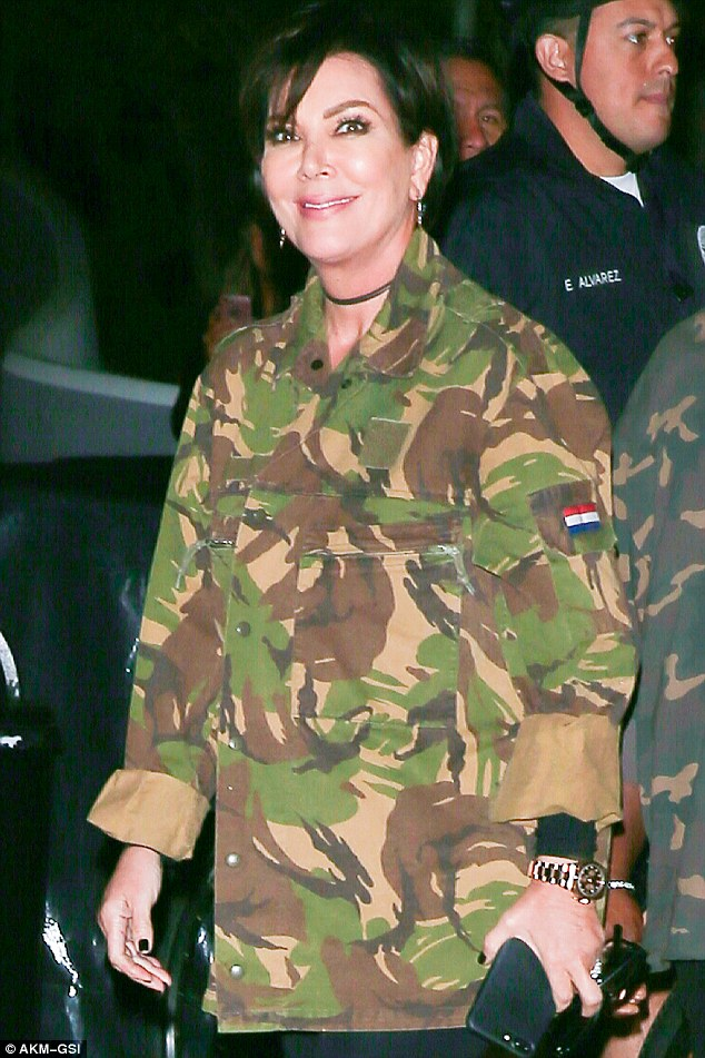Attention: The 60-year-old momager donned a heavy military jacket bearing a Netherlands flag,which she matched with a pair of military-esque heavy black boots.