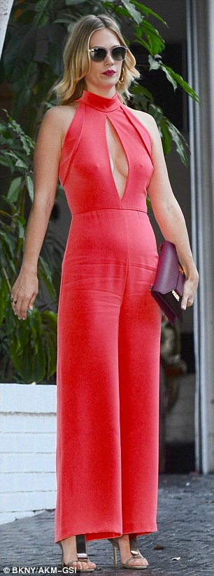 Fashionista: The 38-year-old actress flaunted her God-given assets in a silk peachy halter jumpsuit and metallic stilettos selected by stylist Elizabeth Stewart