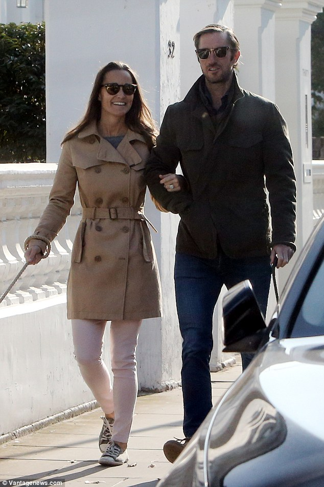Pippa flashed her £200,000 art deco engagement ring as the pair took a stroll