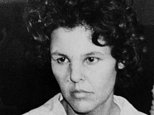 "FILE - In this Oct. 21, 1981 file photo, Judith Clark is taken into police custody in Nanuet, N.Y. Clark, a former radical who drove a getaway car during the 1981 Brinks armored car robbery will be eligible for parole in 2017 following a commutation from New York Gov. Andrew Cuomo on Friday, Dec. 30, 2016. On Monday Jan. 2, 2017, Cuomo said Clark impressed him as ""community-oriented"" when they met and that he believes the former radical should be able to make her case for freedom. But the Democratic governor emphasized that the decision will rest with a parole board. (AP Photo/David Handschuh, File)"
