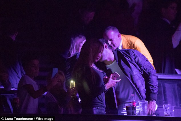 Careless whisper: Kieran whispered into Katie's ear as they watched acts perform at the gig