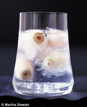 Drink up! Even your cocktails get a Halloween spin this holiday season, thanks to Martha's spook-tacular Bloody Mary recipe and her Eyeball Highball (pictured)