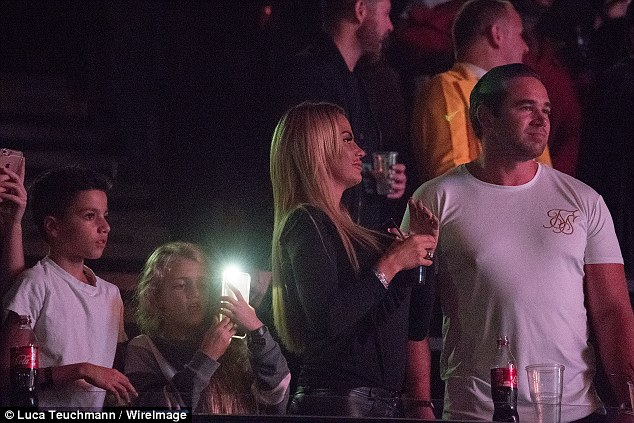 Love-up: Katie looked lovingly at hubby Kieran as daughter Princess and son Junior Andre were immersed in the gig