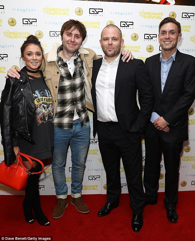 Stylish: The Scottish beauty showed off her slim pins in an oversized jumper dress as she posed with the film's writers Mark Murphy and James Mullinger