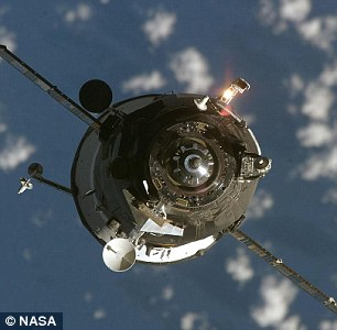 The spacecraft was scheduled to dock with the International Space Station six hours after take off, but that plan has now been 'indefinitely abandoned'. Pictured is a cargo ship in the same family, Progress M-59, as seen from the International Space Station during docking