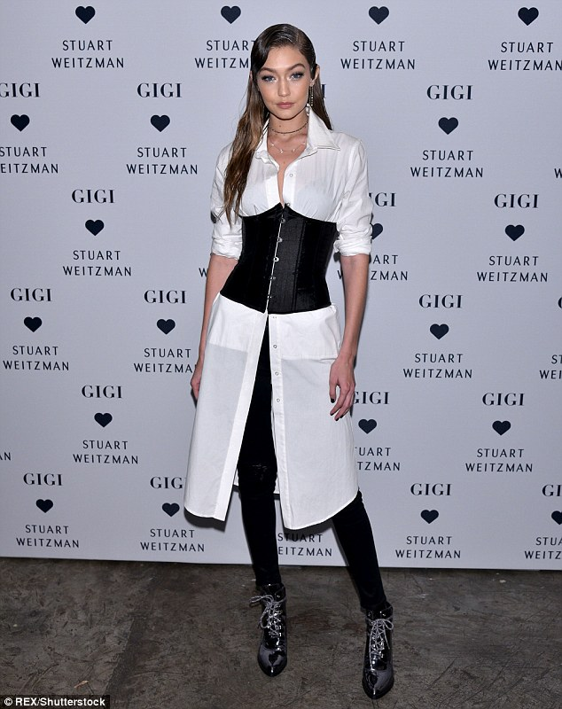 Big night: Gigi Hadidwas her own best advert as she celebrated the launch of her Stuart Weitzman boot collection in New York on Wednesday night