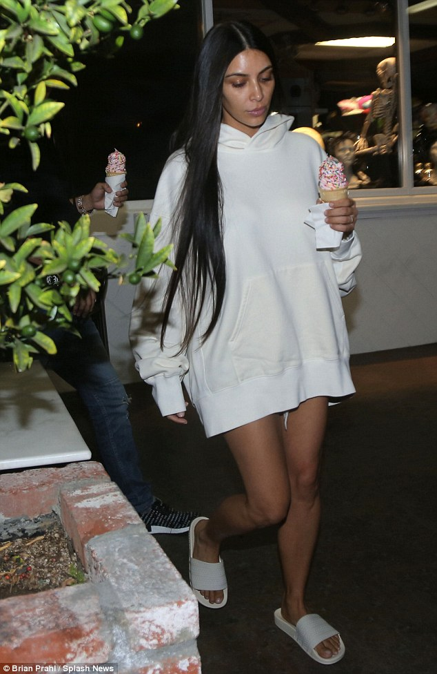 Kim Kardashian (pictured Tuesday night) attended Kanye's concert two nights in a row as she begins to make more public appearances again after her armed robbery ordeal on October 3