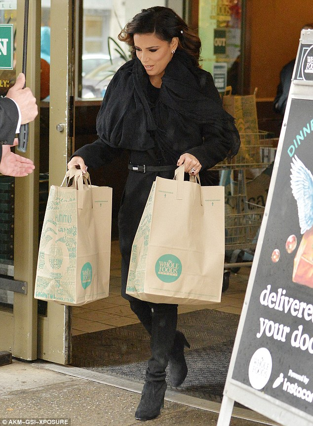She carries her own bags too! Eva Longoria got glammed up to shop at Whole Foods in NYC on Thursday